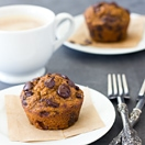 Healthier Pumpkin Chocolate Chip Muffins - Tender and moist, chocolate-filled muffins with no butter, oil, or white flour! | www.brighteyedbaker.com