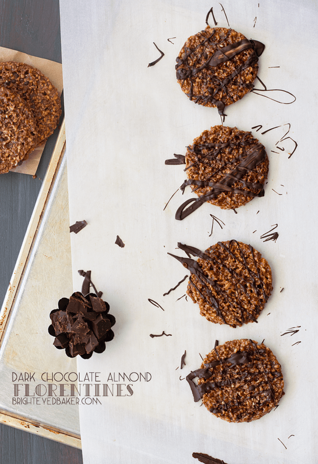 Dark Chocolate Almond Florentines - Thin, crispy, and delicate lace cookies sandwiched and drizzled with bittersweet chocolate. | brighteyedbaker.com
