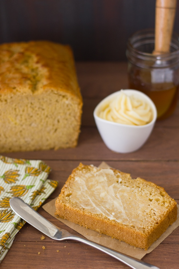 Honey and Beer Cornbread - a fusion of beer bread and cornbread that's tender and perfectly sweet, with crisp edges sweetened by an incredible honey butter glaze. Plus, it's super easy to make! | brighteyedbaker.com