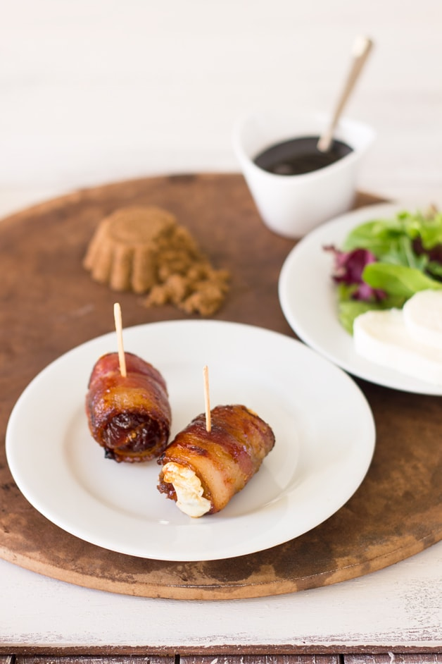 Bacon-Wrapped Dates with Balsamic Reduction - sweet, rich and tender dates stuffed with cheese and wrapped in crispy, smoky bacon with bits of caramelized brown sugar. Say hello to an easy and tasty appetizer!| www.brighteyedbaker.com
