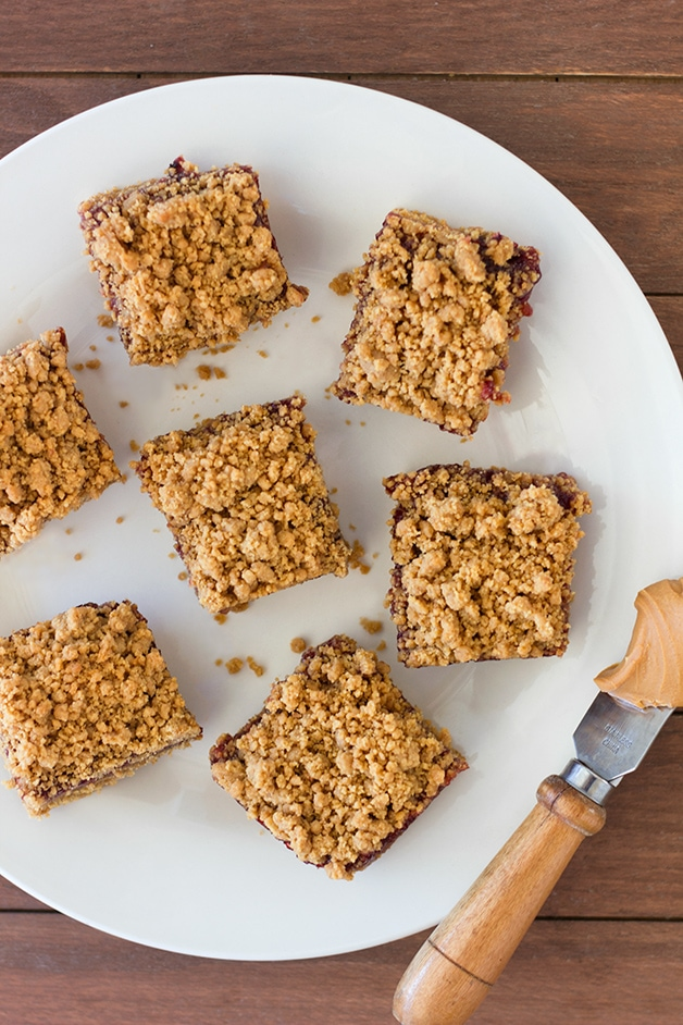 Peanut Butter & Jelly Bars - the classic PB&J sandwich in an irresistible, cookie-like, crumb bar form. | brighteyedbaker.com
