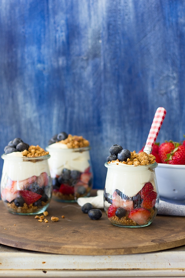 Berries and Cream Parfaits with Graham Cracker Crumble - a light, easy-to-make, and refreshing no-bake dessert that's perfect for summer entertaining. | www.brighteyedbaker.com