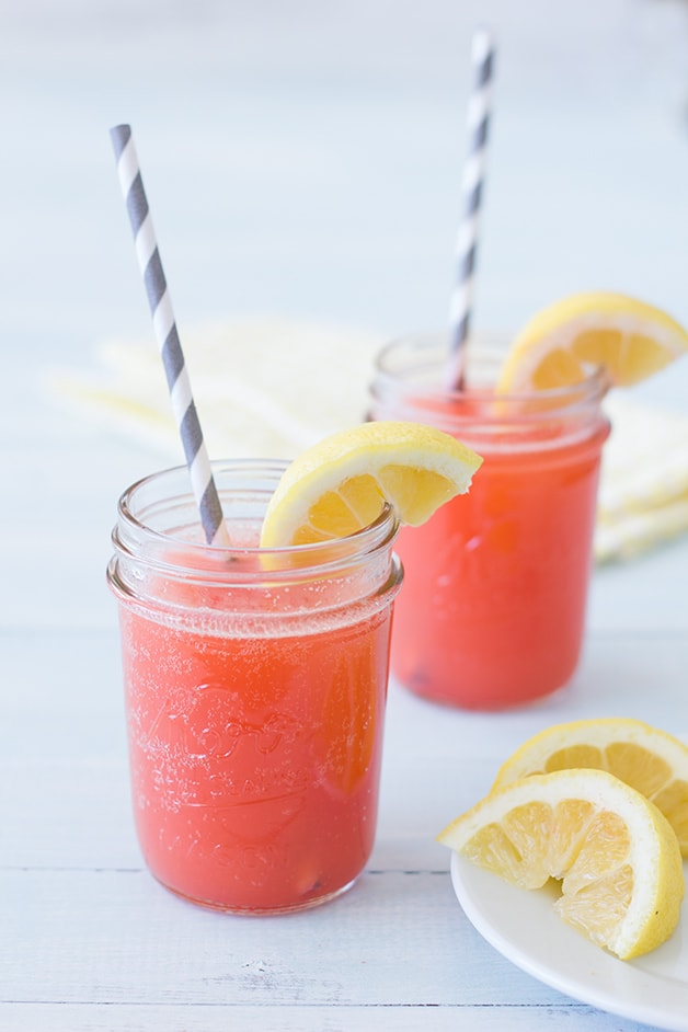 Sparkling Strawberry Lemonade Cooler - a tart-but-sweet, bubbly, and refreshing summer drink perfect for all ages.   www.brighteyedbaker.com