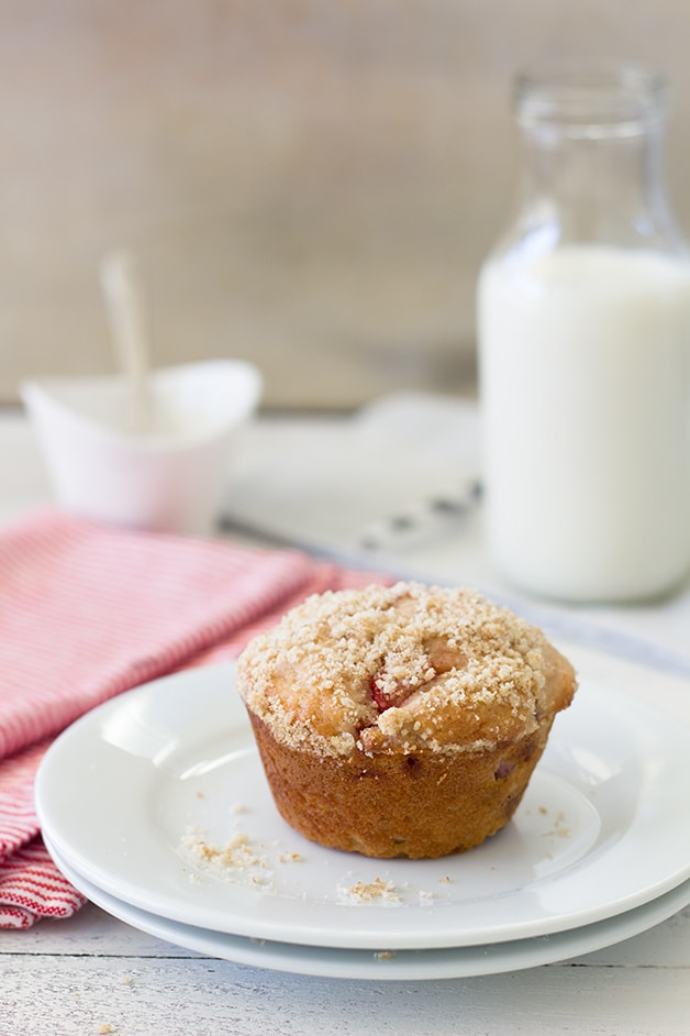 Strawberry Cream Cheese Muffins - fluffy strawberry-studded muffins stuffed with a sweet cream cheese filling and topped with a light crumble topping.   brighteyedbaker.com