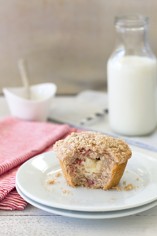 Strawberry Cream Cheese Muffins - fluffy strawberry-studded muffins stuffed with a sweet cream cheese filling and topped with a light crumble topping. | brighteyedbaker.com