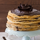 Cookie Butter and Chocolate Ganache Crêpe Cake - a showstopper dessert that doesn't require any fancy cake-decorating skills. |www.brighteyedbaker.com