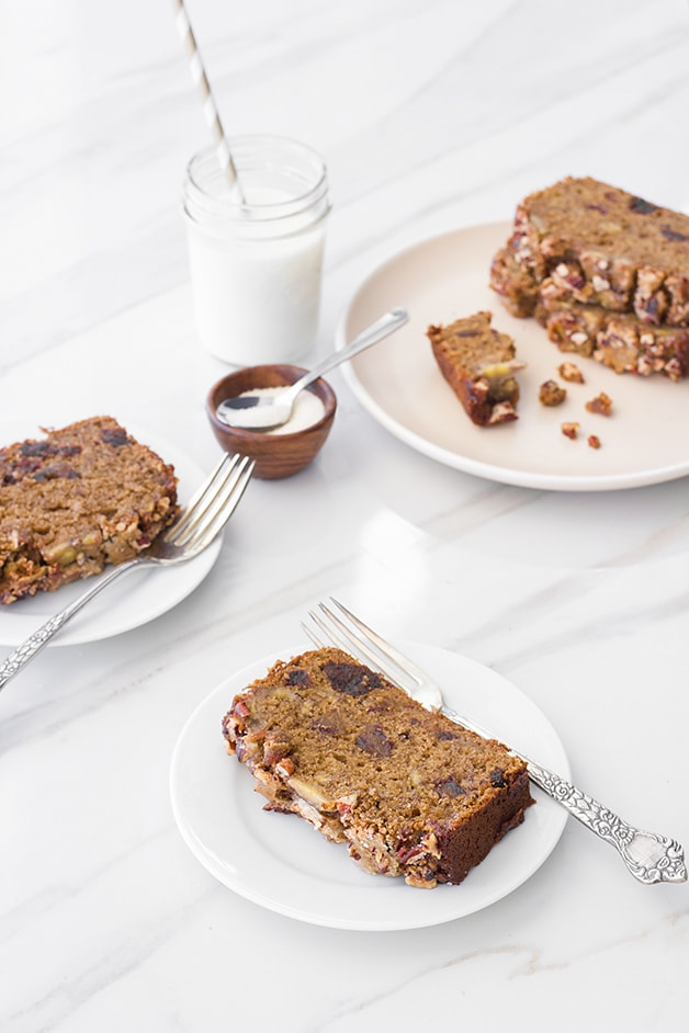 Banana Date Bread - a moist banana bread studded with sweet dates and topped with a caramelized banana-pecan crust. | www.brighteyedbaker.com #wholewheat