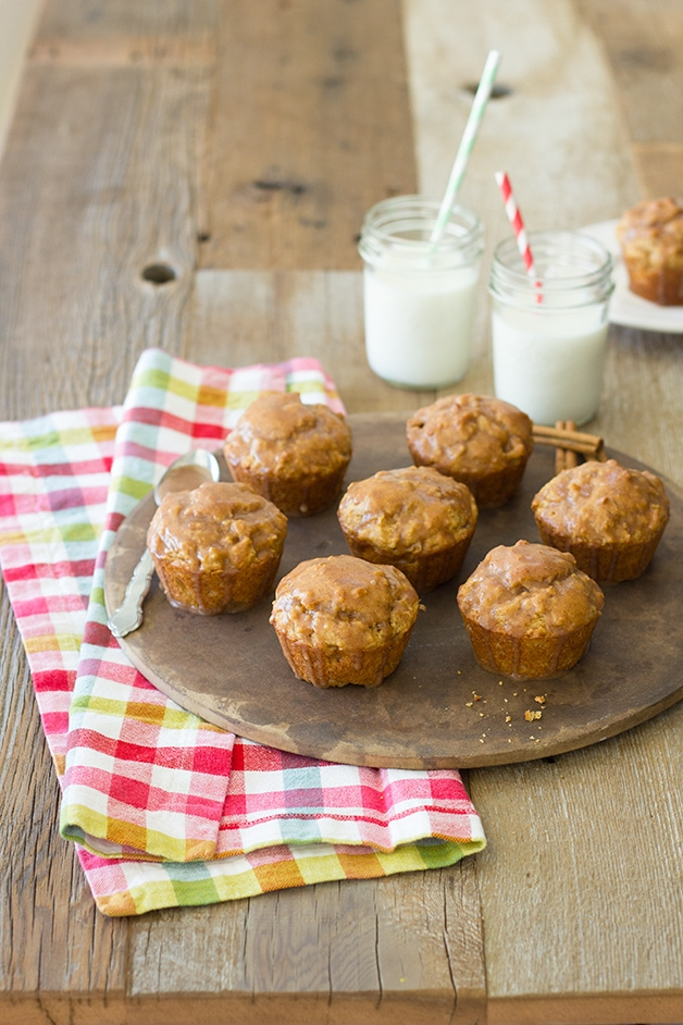 Spiced Apple Muffins with Apple Cinnamon Glaze - an light fall treat that's easy to whip up. | https://www.brighteyedbaker.com #fallrecipes