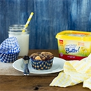Blueberry Jam-Swirled Buttermilk Muffins - Buttermilk muffins flecked with vanilla bean and swirled with sweet blueberry jam - like a classic pancake meal in muffin form. | www.brighteyedbaker.com