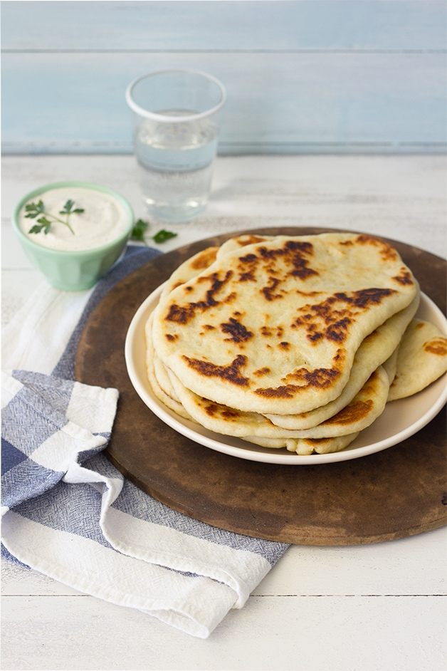 Garlic Naan - There's nothing better than this soft, pillowy naan served warm with a bit of butter or a hot meal. | www.brighteyedbaker.com