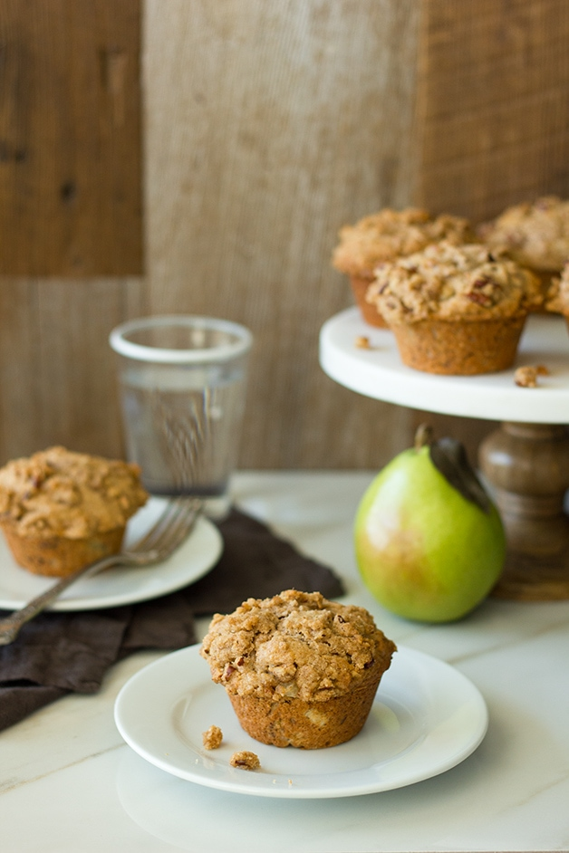 Pear-Pecan Crumb Muffins - Cinnamon and nutmeg spice up this cozy fall muffin, sprinkled with a sweet and crunchy crumb topping. | www.brighteyedbaker.com