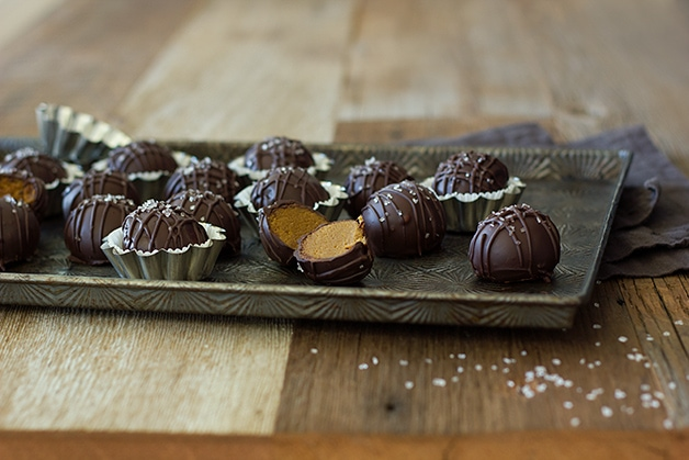 Chocolate-Dipped Gingerbread Cookie Dough Truffles - flavors of sugar and spice make this no-bake dessert a decadent treat! | brighteyedbaker.com