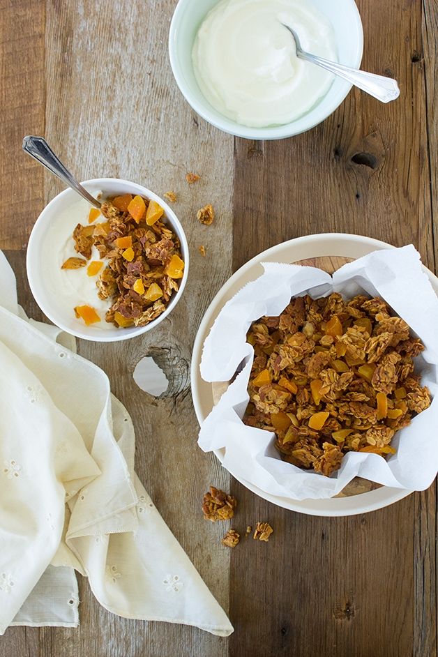 Apricot Almond Granola - loaded with clusters of honey-sweetened almonds and oats, plus tangy dried apricots for a big flavor boost.   www.brighteyedbaker.com