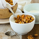 Apricot Almond Granola - loaded with clusters of honey-sweetened almonds and oats, plus tangy dried apricots for a big flavor boost. | www.brighteyedbaker.com