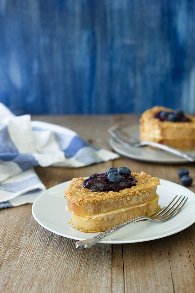 Cream Cheese-Stuffed Baked French Toast & Blueberry Compote - an extravagant, graham cracker-crusted, stuffed french toast. | www.brighteyedbaker.com #oxocookware