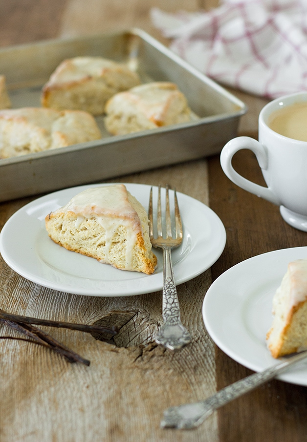 Vanilla Bean Scones | slightly crisp on the outside, tender on the inside, and topped with a sweet vanilla bean glaze for maximum flavor. | www.brighteyedbaker.com