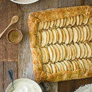 Apple and Almond Galette with Honey Whipped Cream - a light, rustic, fruity dessert. | www.brighteyedbaker.com