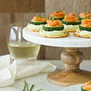 Smoked Salmon & Cucumber Bites with Avocado Cream Cheese - a simple but elegant appetizer to serve for any gathering!   www.brighteyedbaker.com #BretonGlutenFree #CleverGirls