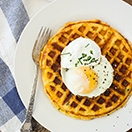 Cheddar & Chive Cornbread Waffles - an extra-cheesy, savory spin on waffles - think breakfast for dinner! | www.brighteyedbaker.com