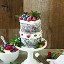 Chocolate Financier Layer Cake with Mascarpone Whipped Cream and Berries {Gluten-Free} | www.brighteyedbaker.com
