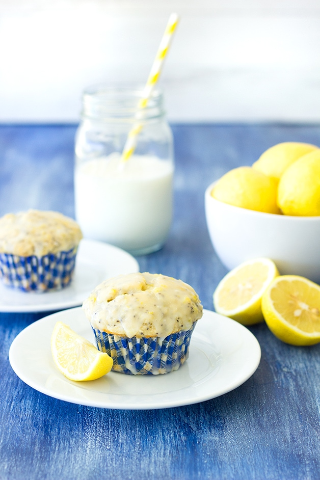 Glazed Lemon Poppy Seed Muffins - fluffy, bakery-style muffins with a big burst of lemon flavor, tons of poppy seeds, and a sweet lemon glaze. | www.brighteyedbaker.com