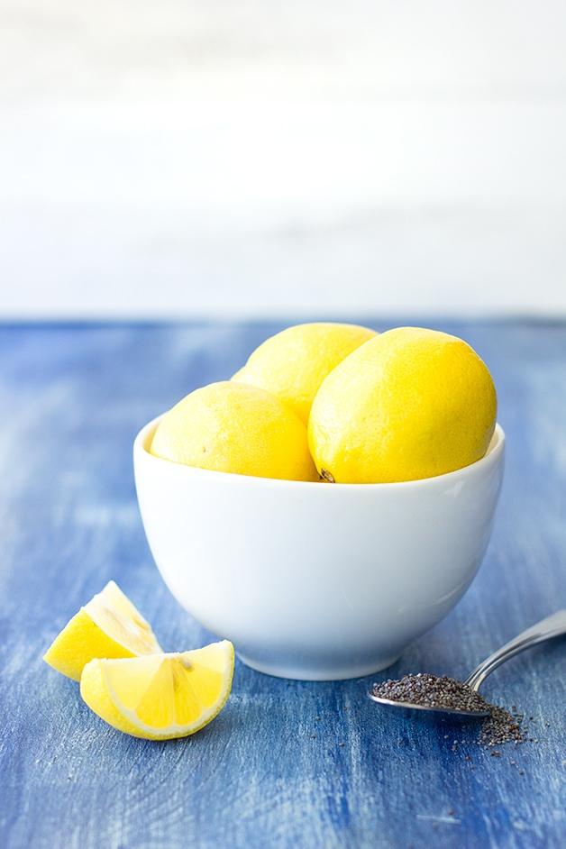 Glazed Lemon Poppy Seed Muffins - fluffy, bakery-style muffins with a big burst of lemon flavor, tons of poppy seeds, and a sweet lemon glaze.   www.brighteyedbaker.com