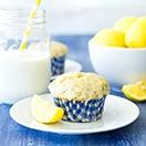 Glazed Lemon Poppy Seed Muffins - fluffy, bakery-style muffins with a big burst of lemon flavor, tons of poppy seeds, and a sweet lemon glaze. | www.brighteyedbaker.com