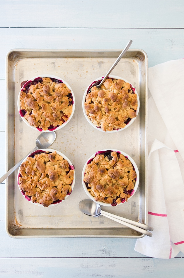 Individual Whole Wheat Mixed Berry Cobblers - mini cobblers loaded with juicy blackberries, raspberries, and blueberries, with a chewy, cookie-like topping. Dairy-free and refined-sugar free! | www.brighteyedbaker.com