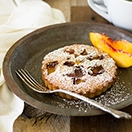 Peach Financiers - classic French brown butter teacakes with slightly crisp edges and a perfectly soft and moist crumb, filled with a nutty sweet flavor and juicy fresh peaches. | www.brighteyedbaker.com