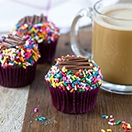 Classic Chocolate Cupcakes -  moist chocolate cupcakes topped with a rich chocolate buttercream and tons of rainbow sprinkles. | www.brighteyedbaker.com
