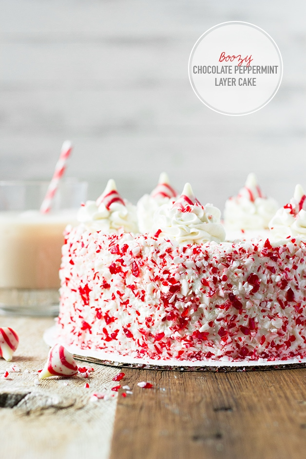Boozy Chocolate Peppermint Layer Cake with Peppermint White Chocolate Frosting - A rich and moist chocolatey cake studded with pepperminty candy cane kisses and wrapped in a creamy, vodka-spiked peppermint white chocolate frosting.   www.brighteyedbaker.com #TreatsWithTitos