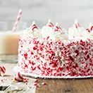 Boozy Chocolate Peppermint Layer Cake with Peppermint White Chocolate Frosting - A rich and moist chocolatey cake studded with pepperminty candy cane kisses and wrapped in a creamy, vodka-spiked peppermint white chocolate frosting. | www.brighteyedbaker.com #TreatsWithTitos