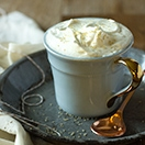 Boozy Eggnog White Hot Chocolate with Rum Whipped Cream - a rich, sweet, creamy, and cozy winter drink - with a little kick! | www.brighteyedbaker.com