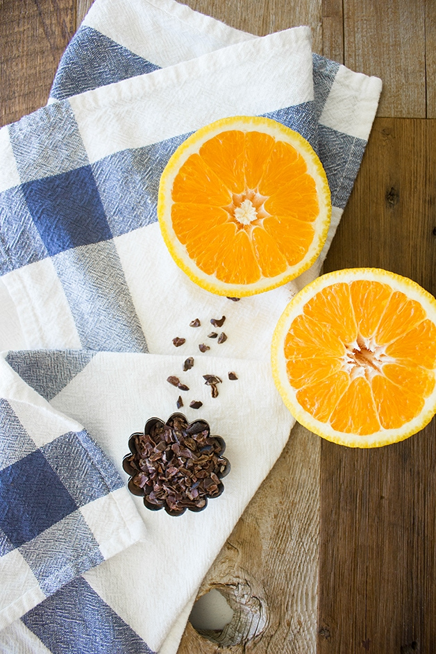 A moist & tender whole wheat muffin with a bright orange flavor, studded with chunks of dark chocolate and crunchy cacao nibs.   www.brighteyedbaker.com