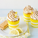 Lemon Meringue Pie Cupcakes - The classic lemon meringue pie turned cupcake, complete with a crunchy graham cracker crust, super-soft lemon cake, tangy lemon curd, and fluffy, sky-high meringue to top it all off. | www.brighteyedbaker.com