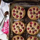 Raspberry Hazelnut Financiers - Super-soft French hazelnut teacakes studded with juicy raspberries, plus a creamy chocolate-hazelnut center. | www.brighteyedbaker.com
