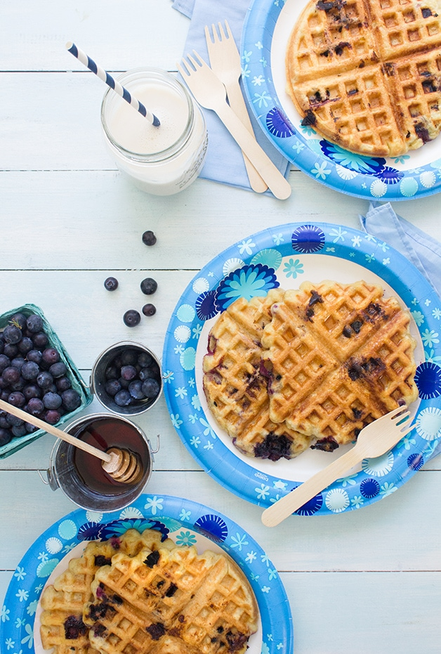 Blueberry Waffles - A simple recipe for gluten-free, dairy-free waffles with crispy edges, fluffy centers, and plenty of fresh summer berries!