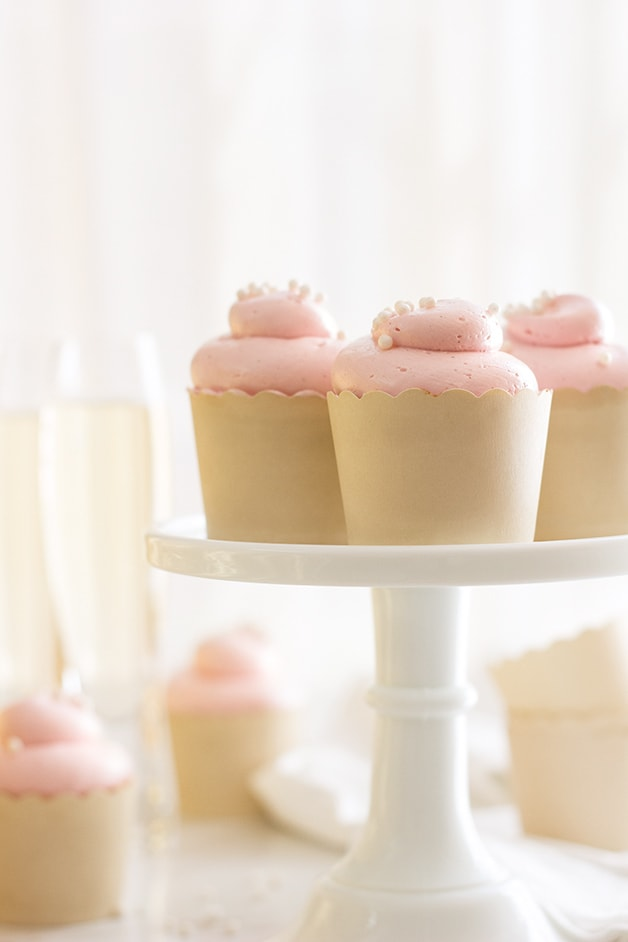 Vanilla Bean & Almond Cupcakes with Roasted Raspberry Swiss Meringue Buttercream - Soft, tender, and light vanilla cupcakes topped with a dreamy, silky-smooth raspberry buttercream. A classy dessert for spring and summertime entertaining!