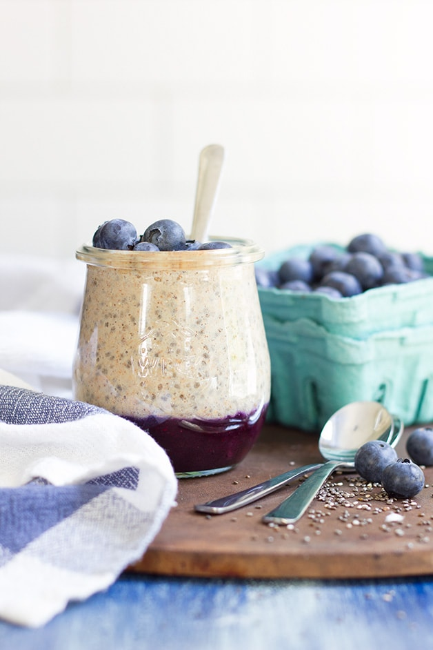 Blueberry & Almond Butter Layered Chia Seed Pudding - a gluten-free, sugar-free, and vegan twist on chia seed pudding with a sweet blueberry compote and topped with a cinnamony almond butter dollop. Guilt-free and SO good. {candida diet friendly}