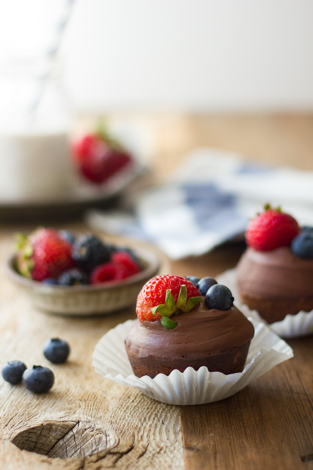 Hazelnut Financier Cupcakes with Whipped Chocolate Ganache - Light & nutty french teacakes topped with a silky coconut milk ganache and fresh berries. A show-stopper dessert that won't destroy your clean eating! {gluten-free, dairy-free, refined sugar-free}