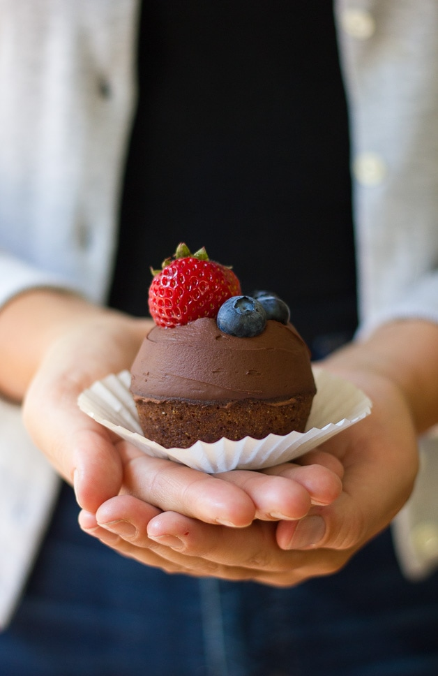 Hazelnut Financier Cupcakes with Whipped Chocolate Ganache - Light & nutty french teacakes topped with a silky dairy-free ganache and fresh berries. A show-stopper dessert that won't destroy your healthy diet! {gluten-free, dairy-free, refined sugar-free}