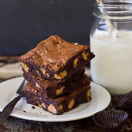 Fudgy Flourless Peanut Butter Cup Brownies - The ULTIMATE rich, oooy-gooey, and chocolatey brownies, with perfectly-crinkled tops and chunks of peanut butter cups in every bite.