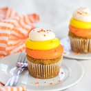 Soft & tender pumpkin spice cupcakes topped with a tangy cream cheese frosting that's piped into a fun candy corn-colored swirl. Makes for a perfect fall dessert & Halloween treat!