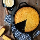 Soft and tender gluten-free cornbread with a crispy golden crust, speckled with flecks of vanilla bean.