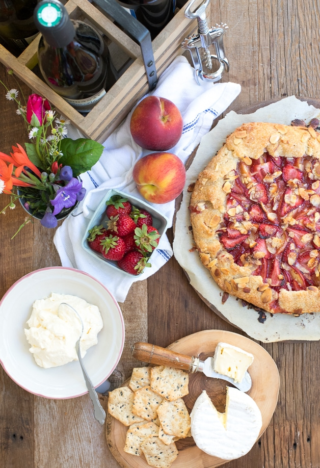 A butter, flaky galette with a juicy strawberry-peach filling and a crispy almond-speckled crust.