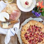A buttery, flaky galette with a juicy strawberry-peach filling and a crispy almond-speckled crust.
