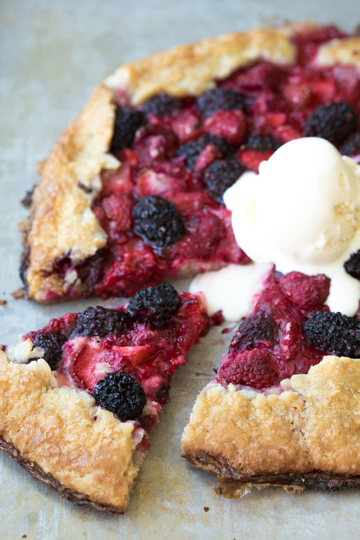 Summer dessert at its finest - mixed berries piled high over a flaky, buttery gluten-free pie crust, with a sweet cream cheese layer in the middle.