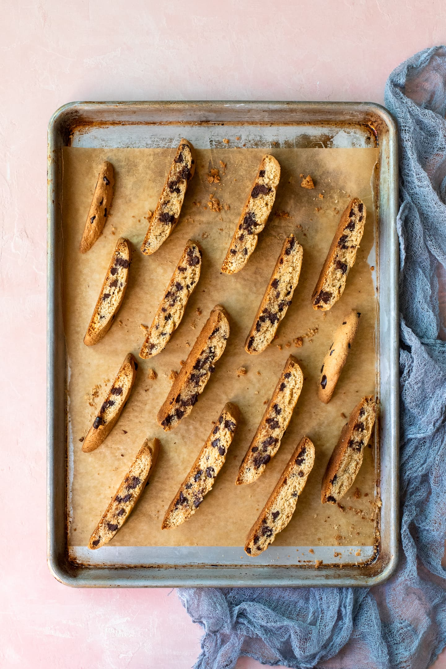 Sliced biscotti arranged on a baking sheet in preparation for the second bake.