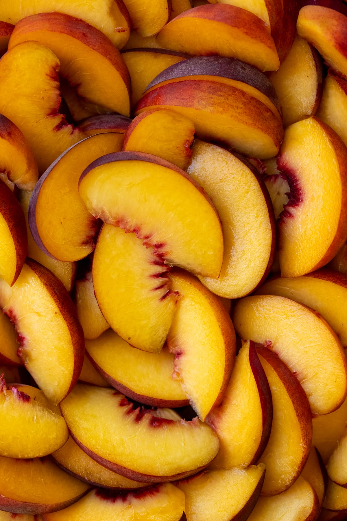 Overhead close up of peach slices.