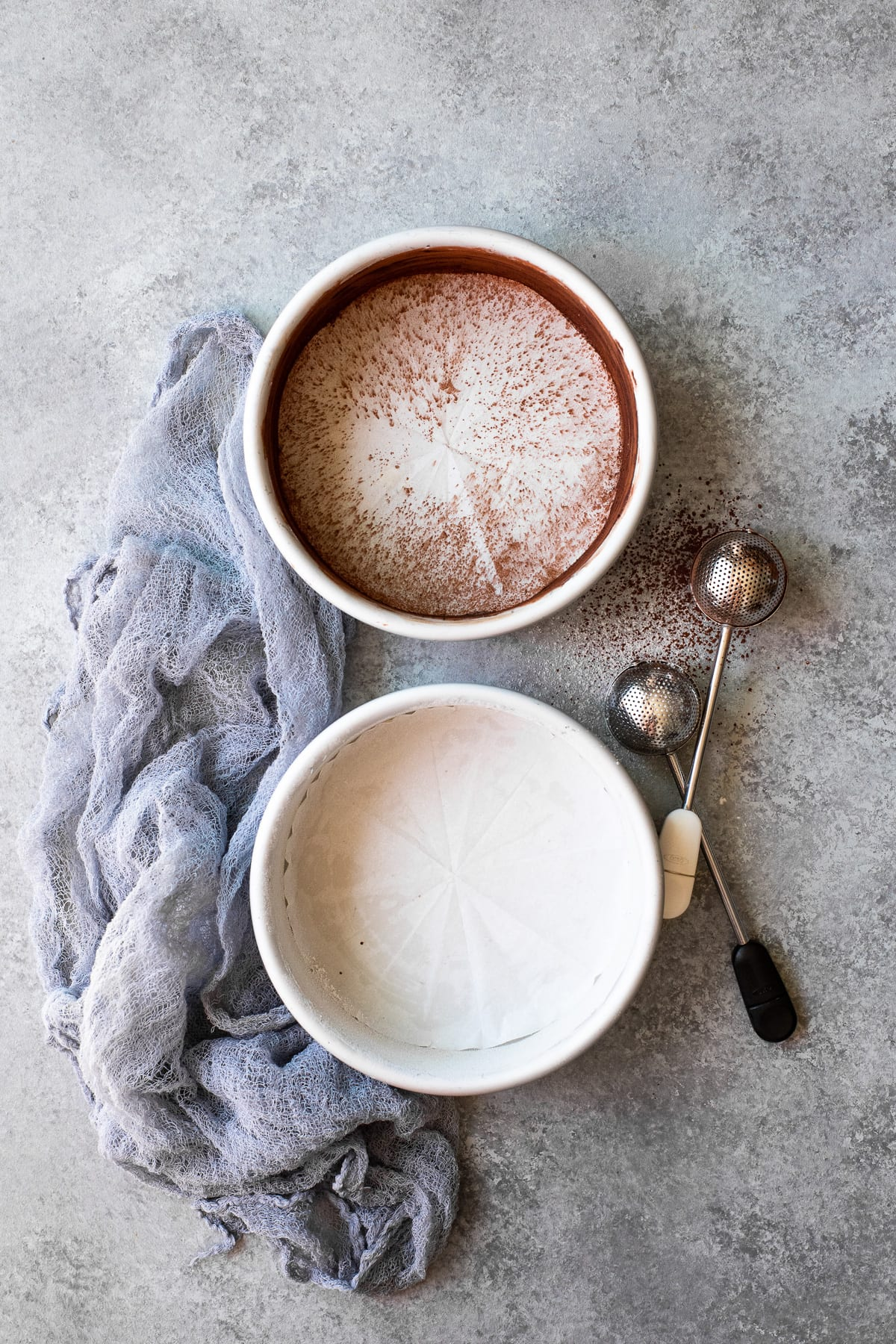 Two cake pans greased, floured, and lined with parchment